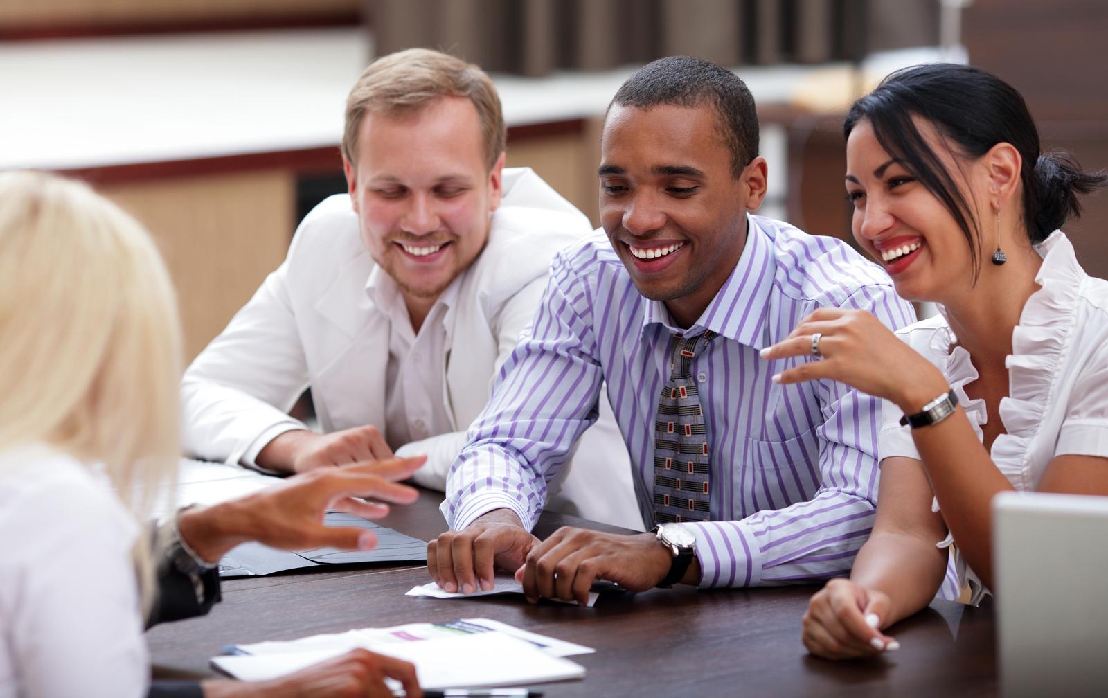 bigstock-Happy-business-people-sitting--26892563